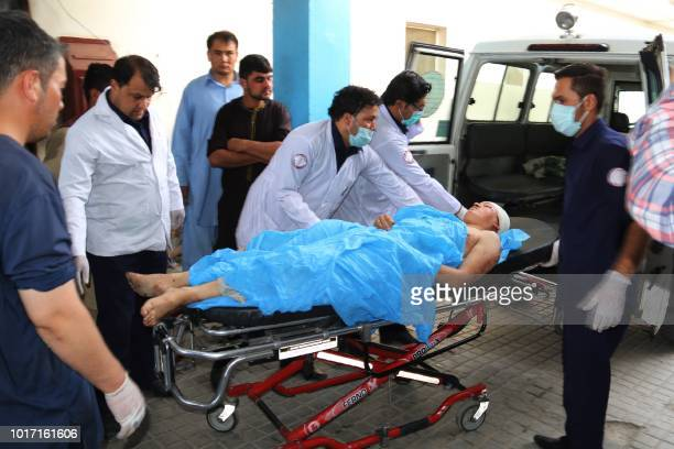 Afghan volunteers carry an injured youth on a stretcher to a hospital following a suicide attack in Kabul on August 15 2018 At least 37 people the...
