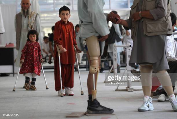Afghan war amputees and children practice walking at the International Committee of the Red Cross orthopedic center on September 10 2011 in Kabul...