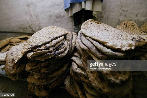 Afghan war widows bake bread under a UN World Food Program project September 8 in Kabul Afghanistan The women bake 19002000 pieces of Afghani bread...
