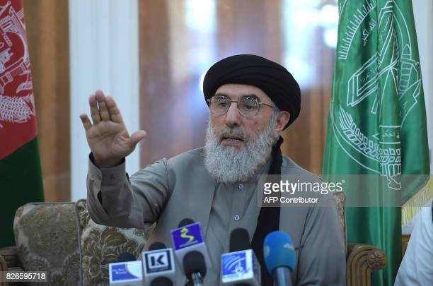 Afghan warlord and exprime minister Gulbuddin Hekmatyar gestures while speaking during a press conference in Kabul on August 5 2017 / AFP PHOTO /...