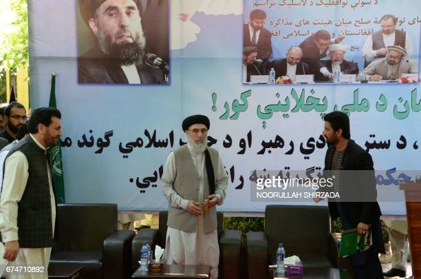 Afghan warlord and ex-prime minister Gulbuddin Hekmatyar gestures as he greets supporters at a rally in Laghman province on April 29, 2017. Hekmatyar...