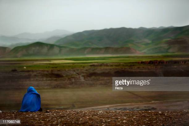 Afghan woman waiting to cross the Kokchah River below May 17 2009 in Takhar Province Afghanistan