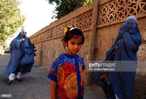 Afghan women and a young girl walk July 25 1996 in Herat Afghanistan The women are not allowed to study or work by the ruling Taliban regime who took...