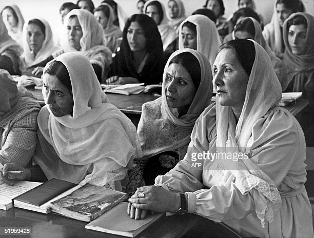 Afghan women attend a work-place literacy course in Kabul in the 80s when the country was ruled by the Mocow-backed Kabul communist government....