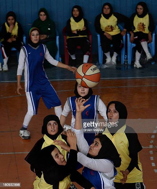 Afghan women basketball players from Herat province compete with Kabul's team in a friendly match at the National Olympic Stadium in Kabul on...
