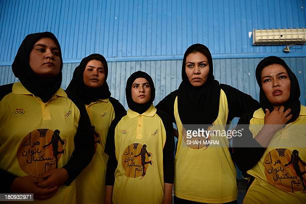 Afghan women basketball players from Herat province prepare to compete with Kabul's team in a friendly match at the National Olympic Stadium in Kabul...