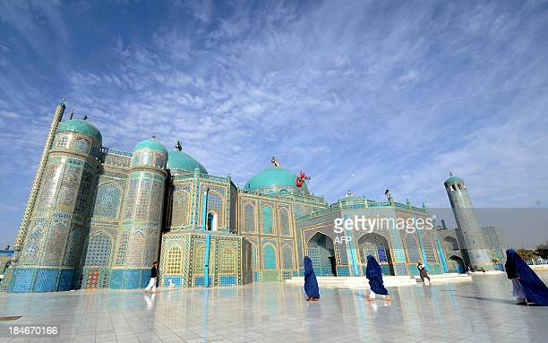 Afghan women go to the main mosque to offer EidalAdha prayers in the main mosque in the city of MazariSharif in Balkh province on October 15 2013...