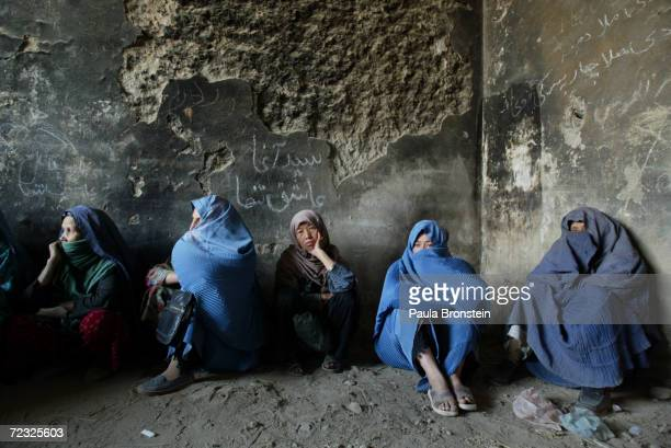 Afghan women line up for monthly food rations from the US based international organization CARE October 17 2004 Kabul Afghanistan An estimated 9500...