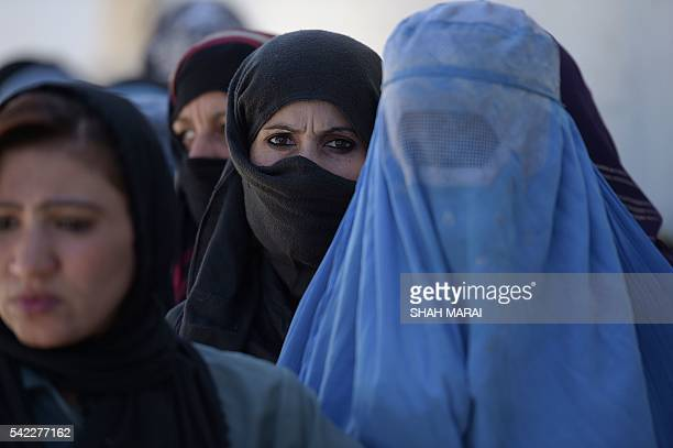 Afghan women line up to receive food donations during the month of Ramadan in Kabul on June 23 2016 Afghanistan's Chamber of Commerce and Industries...