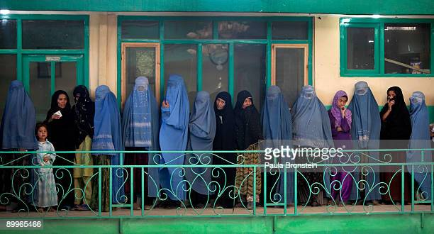 Afghan women line up to vote at a polling station August 20 2009 in Kabul Afghanistan Afghans voted Thursday to elect a president for the second time...