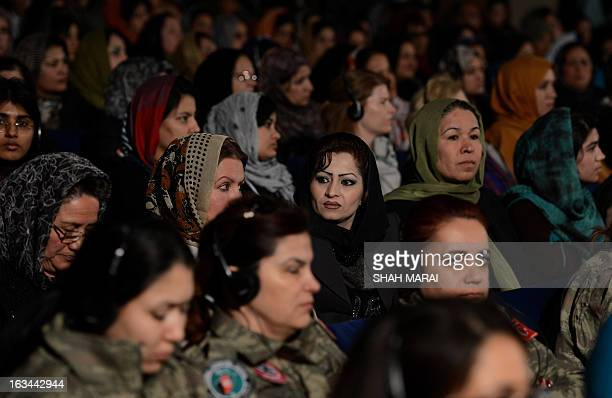 Afghan women listen to President Hamid Karzai speak during a gathering of women to mark International Women's Day in Kabul on March 10 2013 Karzai...