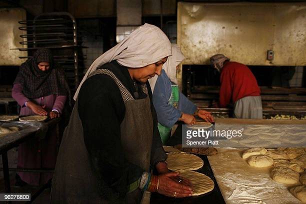 Afghan women make bread at the Silos bread factory on January 30 2010 in Kabul Afghanistan The factory which employs roughly 340 people provides a...