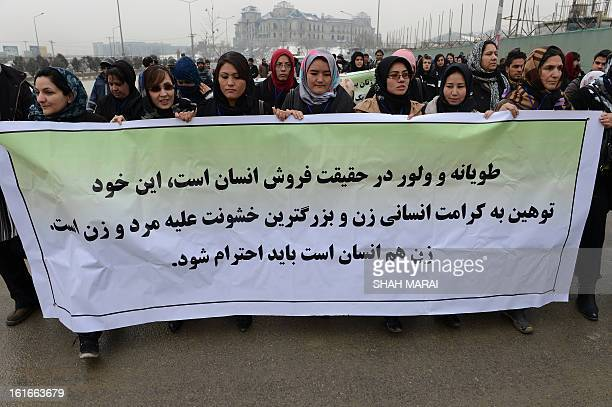Afghan women march during a protest calling for an end to violence against women in Afghanistan and around the world in Kabul on February 14 2013...