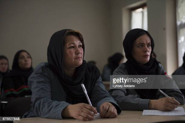 Afghan women Nazifa left from Ghazni and Gulchin right from Baghlan attend classes with other women from across Afghanistan while training at the...