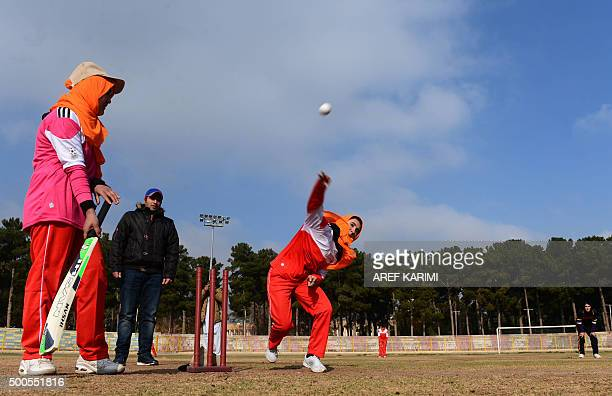 Afghan women play cricket at the grounds of the stadium in Herat on December 9, 2015. Womens sports participation in Afghanistan has increased since...