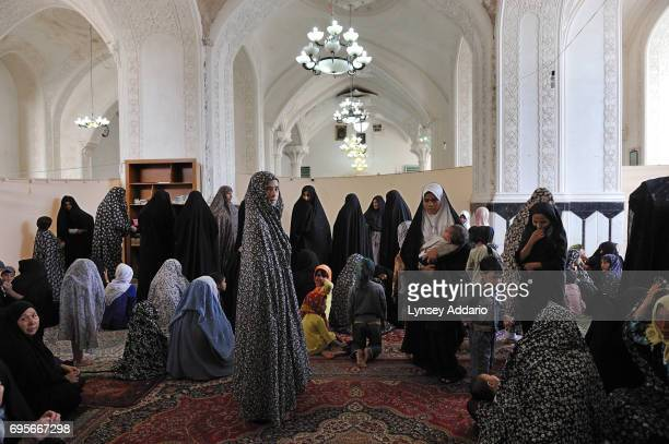 Afghan women pray at a shrine in Herat Afghanistan August 6 2010 Hundreds if not thousands of Afghan women commit suicide by selfimmolation each year...