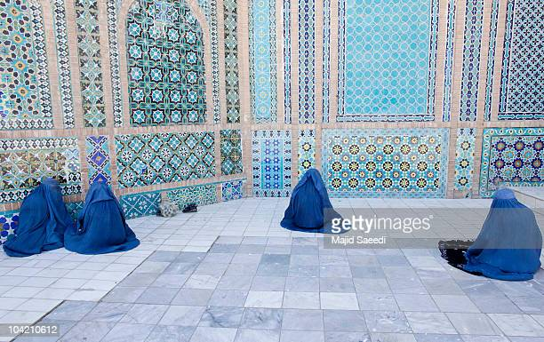 Afghan women pray at the Blue Mosque a day before the parliamentary election September 17 2010 in Mazaresharif Afghanistan Security is of gaining...