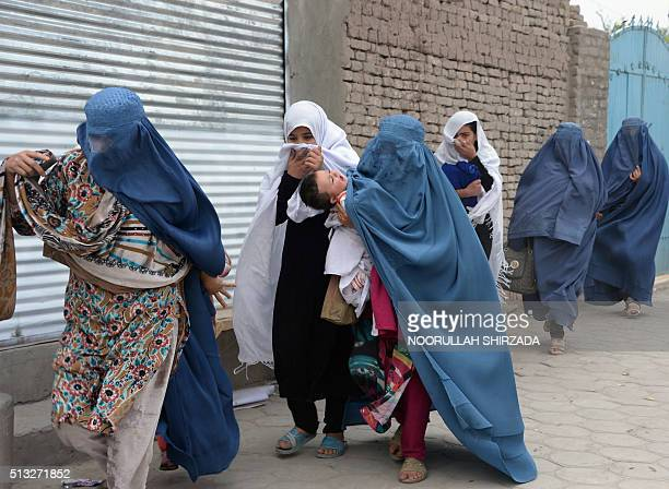 Afghan women run from the site of an attack in front of the Indian consulate in Jalalabad on March 2 2016 Explosions and gunfire echoed on March 2 as...