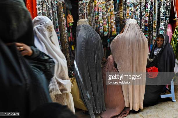Afghan women shop in the women's bazaar in Kandahar in Afghanistan April 23 2009 Several months ago about one dozen young girls were sprayed with...