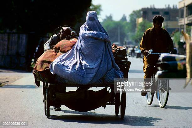 afghan women sitting on a cart in kabul - per-anders pettersson stock pictures, royalty-free photos & images