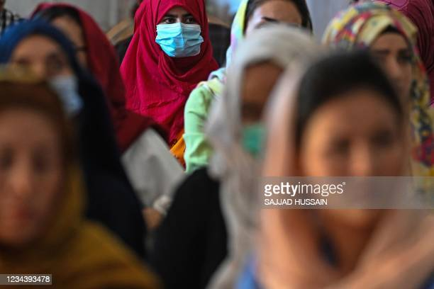 Afghan women take part in a gathering at a hall in Kabul on August 2, 2021 against the claimed human rights violations on women by the Taliban regime...