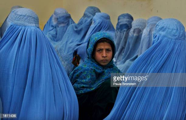 Afghan women wait in line to be treated at the Kalakan health clinic February 232003 in Kalakan Afghanistan