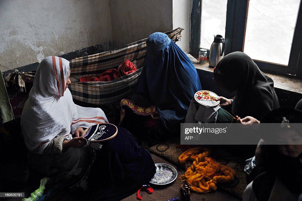 Afghan women work at a traditional sewing workshop on the outskirts of Jalalabad on February 2, 2013. During the Taliban regim women were ban to work or study out of their home but after the US and international troops presnce from 2001, women are allowed to work and study. AFP PHOTO/Noorullah Shirzada