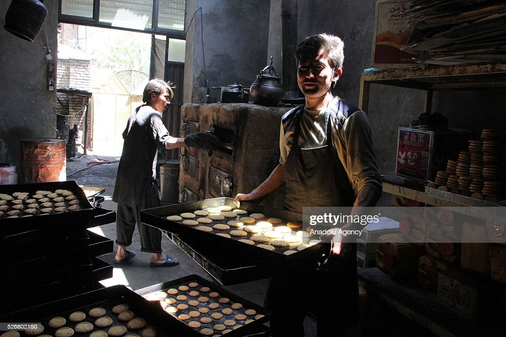 Afghan workers are seen as they work at a traditional sweet factory as the world marks International Labor Day, also known as May Day in Kabul, Afghanistan, on May 1, 2016.