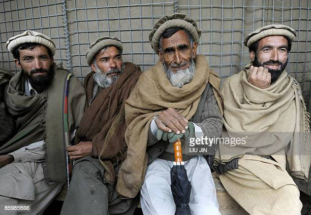 Afghan workers wait for job distribution at ISAF's Camp Bostick in Naray, in the eastern Kunar province on April 15, 2009. United States President...