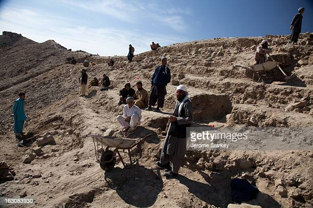 Afghan workmen excavate a hillside at Mes Aynak, the site of an ancient copper mine in Logar province, 35km south of Kabul, Nov 14, 2011 More than...