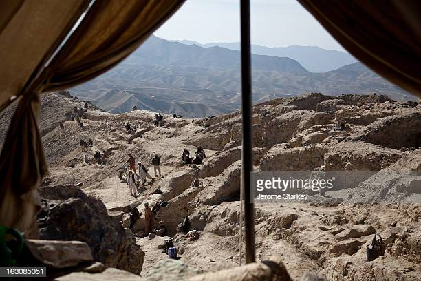 Afghan workmen excavate a hillside at Mes Aynak, the site of an ancient copper mine in Logar province, 35km south of Kabul, Nov 14, 2011. As seen...