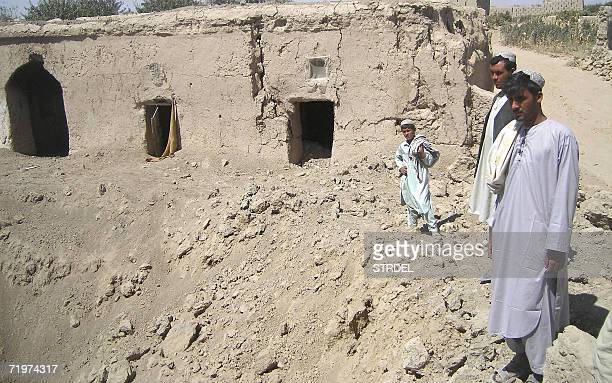 TALIBAN Afghan youths pose beside a crater on the edge of their home in Pashmul 21 September 2006 In Pashmul and the adjoining districts of Panjwayi...