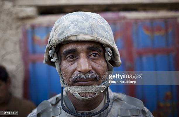 AfghanAmerican Mohammad Safi 41 years originally from Kabul Afghanistan now living in Lawrenceville Georgia patrols the partially deserted market as...
