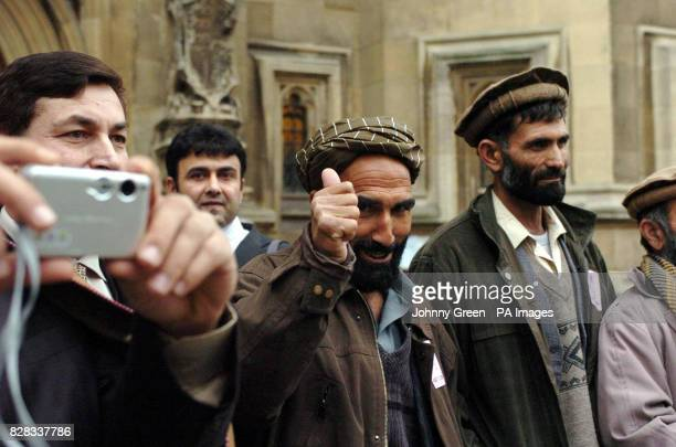 Afghani farmers Mohammad Ata and Mohammad Alam leave the Houses of Parliament in central London Monday February 6 where they urged MPs not to destroy...