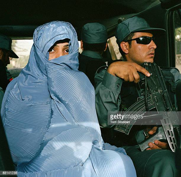 Afghani Member of Parliament Malalai Joya hidden by her burqa pictured with her bodyguards driving through the backstreets of Kabul The fiery young...