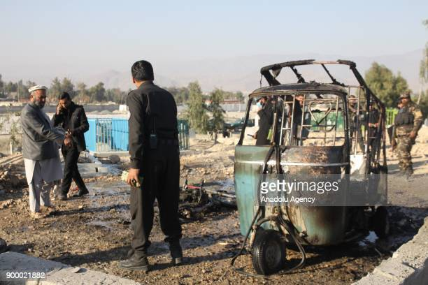 Afghani officials inspect the site after a suspected suicide attack targeting a funeral in Nangarhar Province Afghanistan on December 31 2017 15...