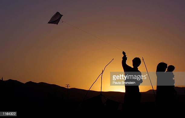 Afghani refugees living at the Pung Puti refugee camp on the outskirts of Quetta Pakistan fly a kite September 29 2001 at sunset The refugees who...