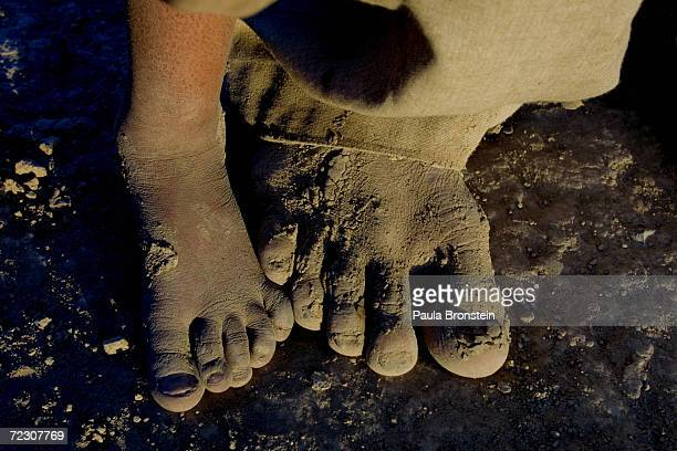 Afghani refugees living at the Pung Puti refugee camp on the outskirts of Quetta Pakistan stand in bare feet September 29 2001 The refugees who have...