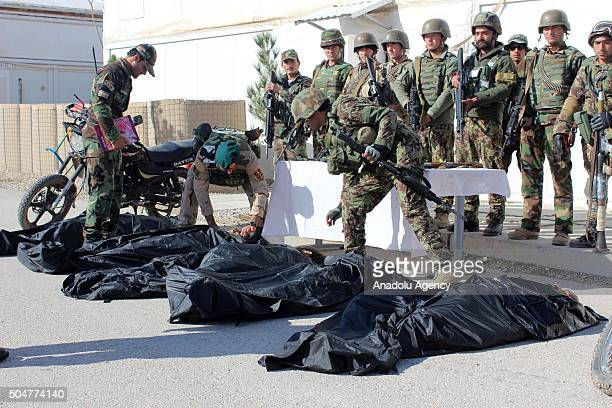 Afghani security forces prepare to carry the bodies of 5 Taliban militants who have been killed by Afghani security forces to a vehicle in Cevizcan...