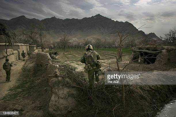 Afghanistan 2009. Australian soldiers conduct a foot patrol of Qalas compounds near chora that house one or more Afghani families. They will be...
