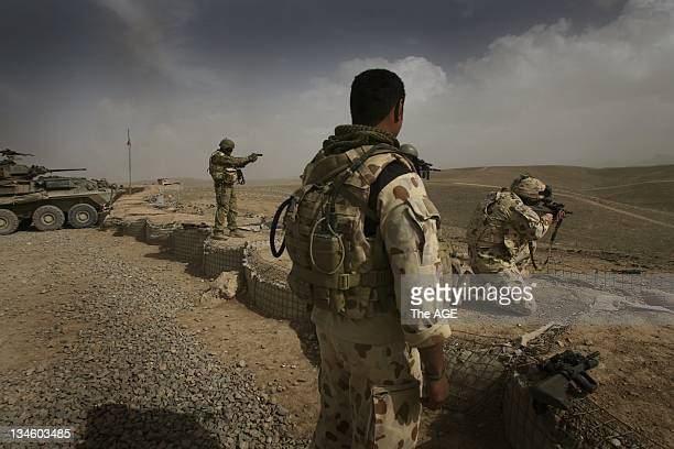 Afghanistan 2009. Australian soldiers discharge their weapons before entering Tarin Kowt. They have just returned from patrol in the Baluchi Valley.