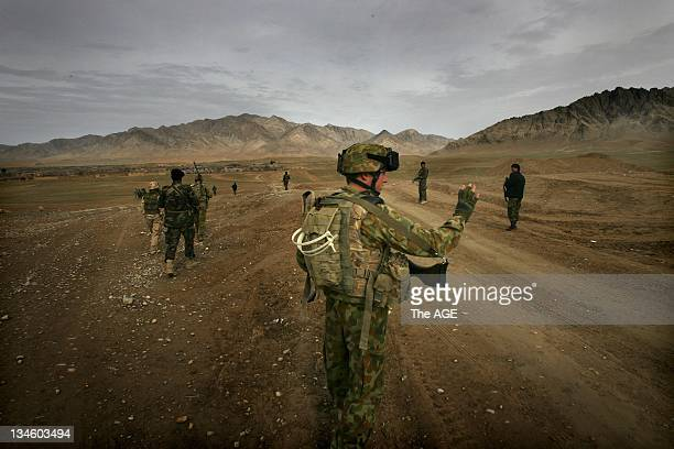 Afghanistan 2009. Soldiers from the Australian Defence Force and the Afghanistan National Army conduct foot patrols around Base Buman near the...
