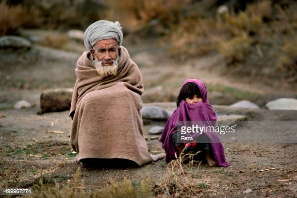 1983 Afghanistan A little girl and her grandfather on the road to exile The war against the Soviet invaders had been raging for four years Towns and...