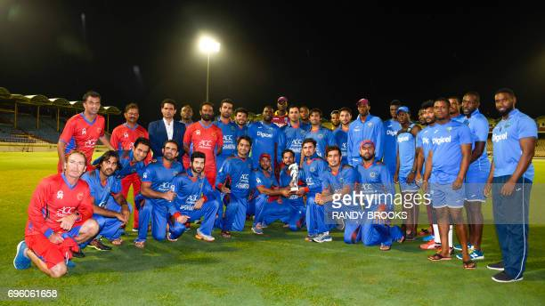 Afghanistan and West Indies teams pose with the trophy at the end of the 3rd and final ODI match between West Indies and Afghanistan at Darren Sammy...