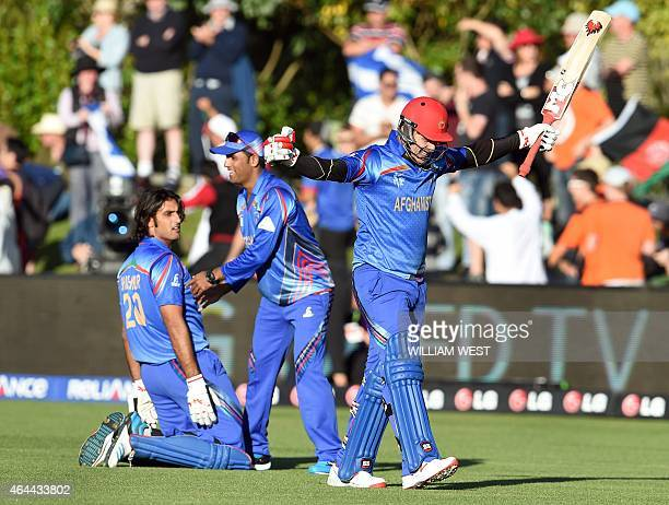 Afghanistan batsman Hamid Hassan celebrates with teammate Shapoor Zadran and reserve Usman Ghani after they defeated Scotland in their 2015 Cricket...