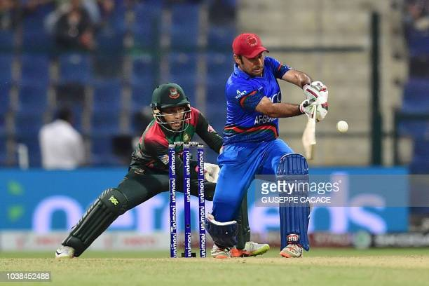 Afghanistan batsman Mohammad Asghar plays a shot during the one day international Asia Cup cricket match between Afghanistan and Bangladesh at The...