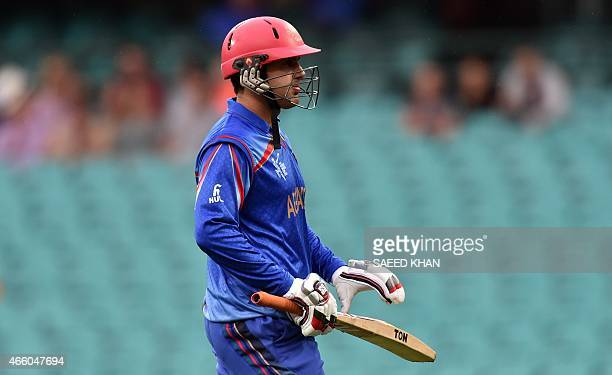 Afghanistan batsman Mohammad Nabi walks back to the pavilion following his dismissal during the 2015 Cricket World Cup Pool A match between England...
