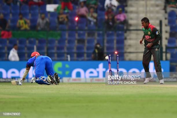 Afghanistan batsman Rahmat Shah is dismissed by Bangladesh Nazmul Islam during the one day international Asia Cup cricket match between Afghanistan...