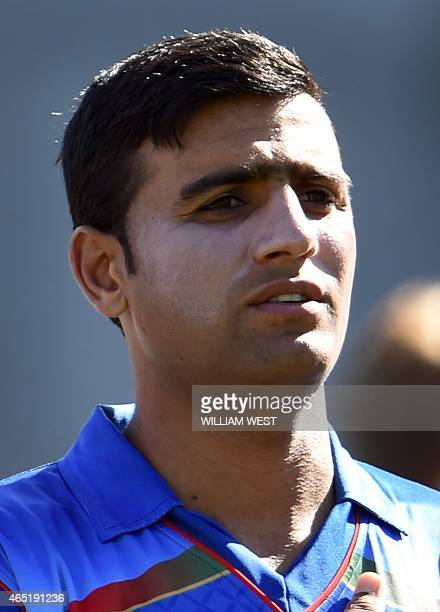 Afghanistan batsman Usman Ghani stands for the national anthem before the start of the Afghanistan versus Scotland 2015 Cricket World Cup Group A...