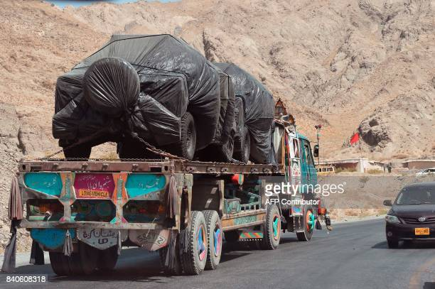 Afghanistan bound NATO supply trucks carry new vehicles making their way in Killa Abdullah on August 29 2017 Pakistan has postponed a visit by a US...